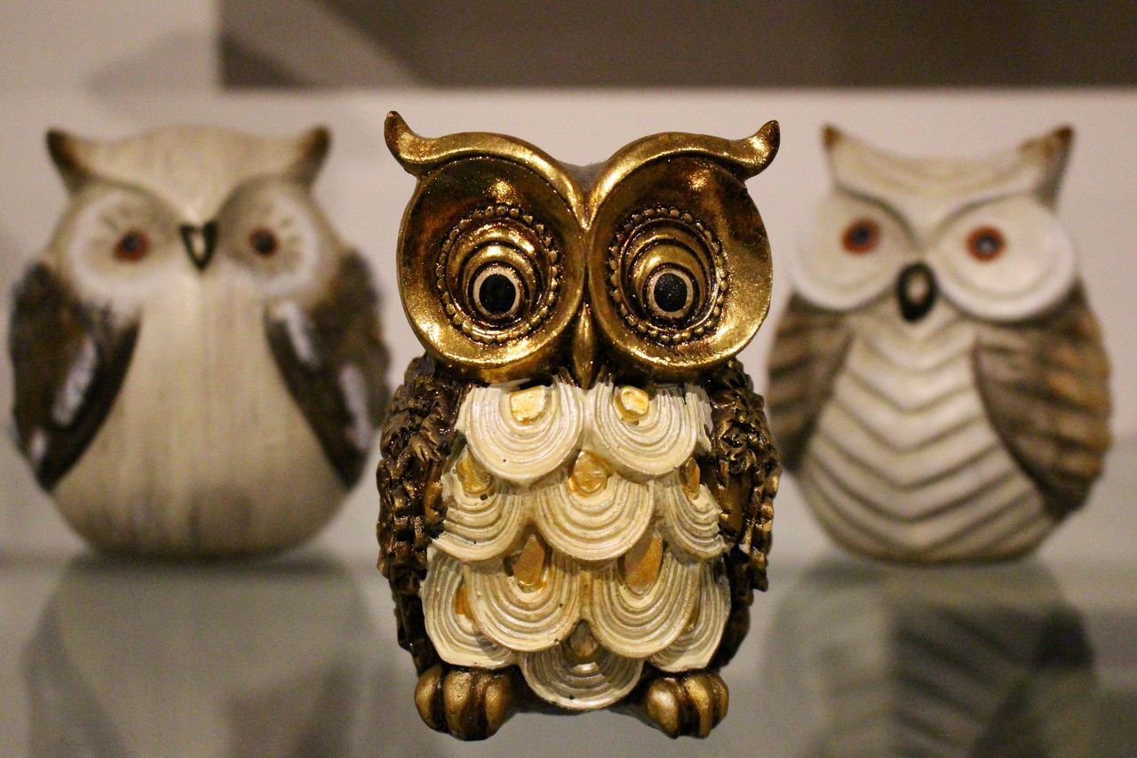 animal representation, art and craft, indoors, no people, gold colored, ornate, close-up, focus on foreground, day