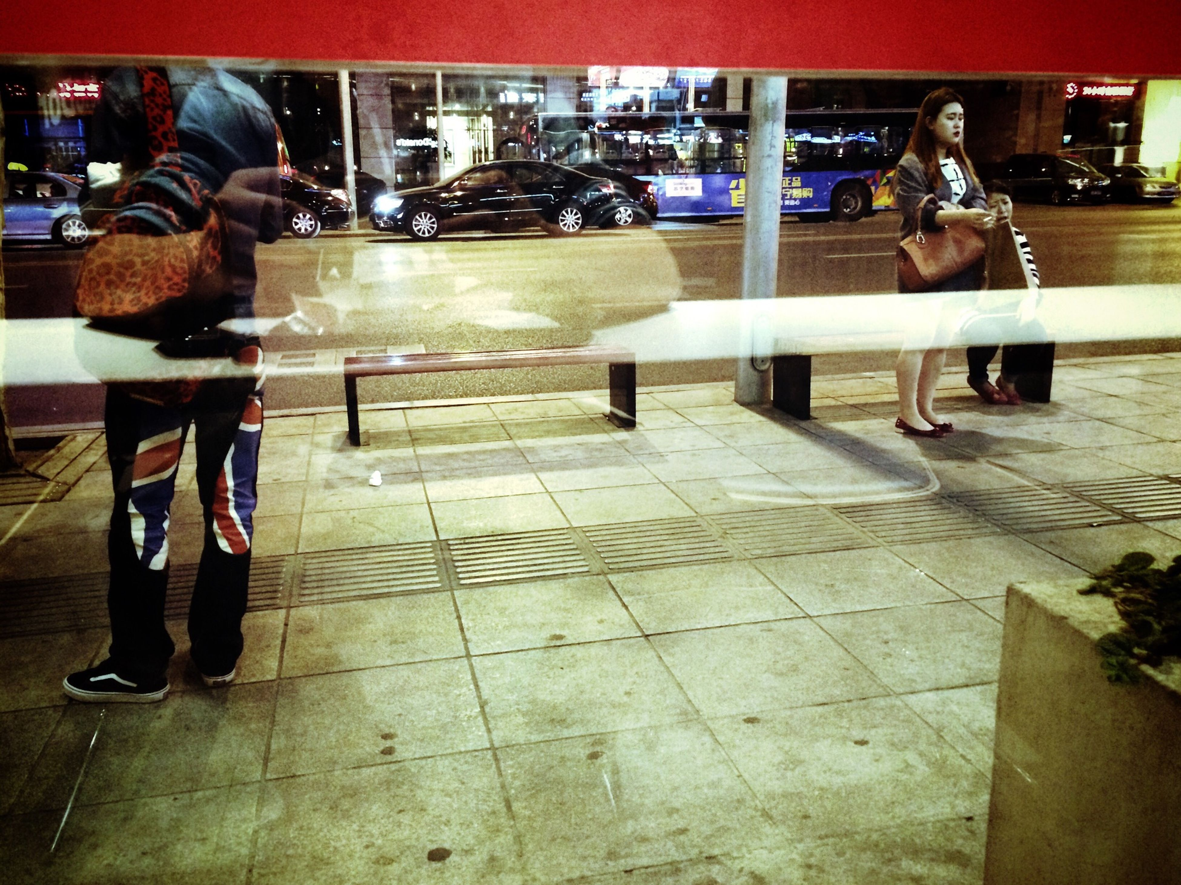 indoors, men, lifestyles, standing, person, casual clothing, sitting, leisure activity, table, full length, restaurant, rear view, incidental people, reflection, low section, public transportation
