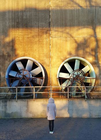 Symmetry Built Structure Architecture Sunlight Building Exterior One Person Outdoors Wintersun Shadow Abandoned Factory Facades Industry Steelwork Faded Rusty Adapted To The City Round Objects Air Duct Technology Architecture Female Model Coat The City Light Vintage The Architect - 2017 EyeEm Awards