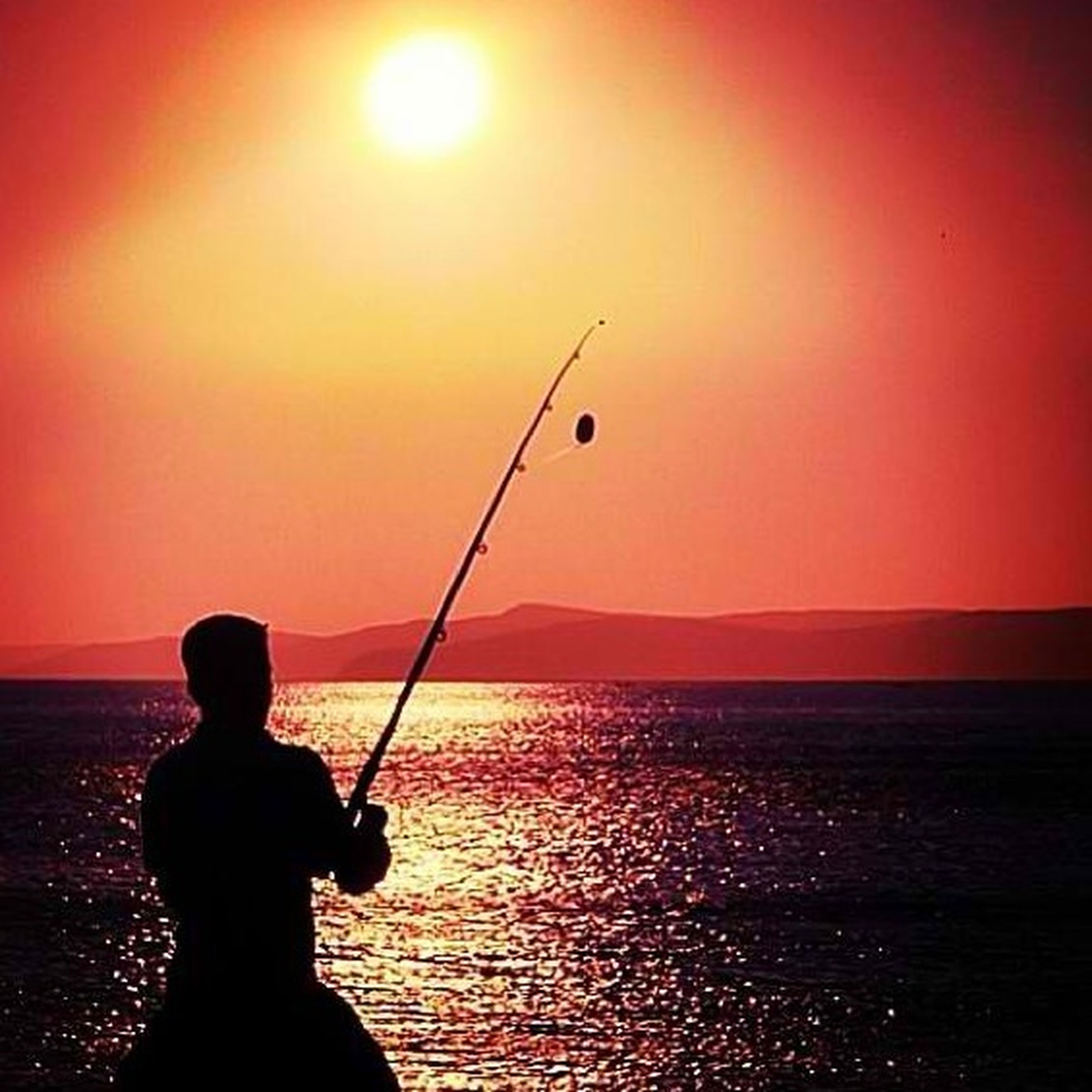 sunset, sun, sea, silhouette, horizon over water, water, scenics, beauty in nature, orange color, tranquil scene, leisure activity, lifestyles, tranquility, idyllic, men, nature, sky, fishing rod