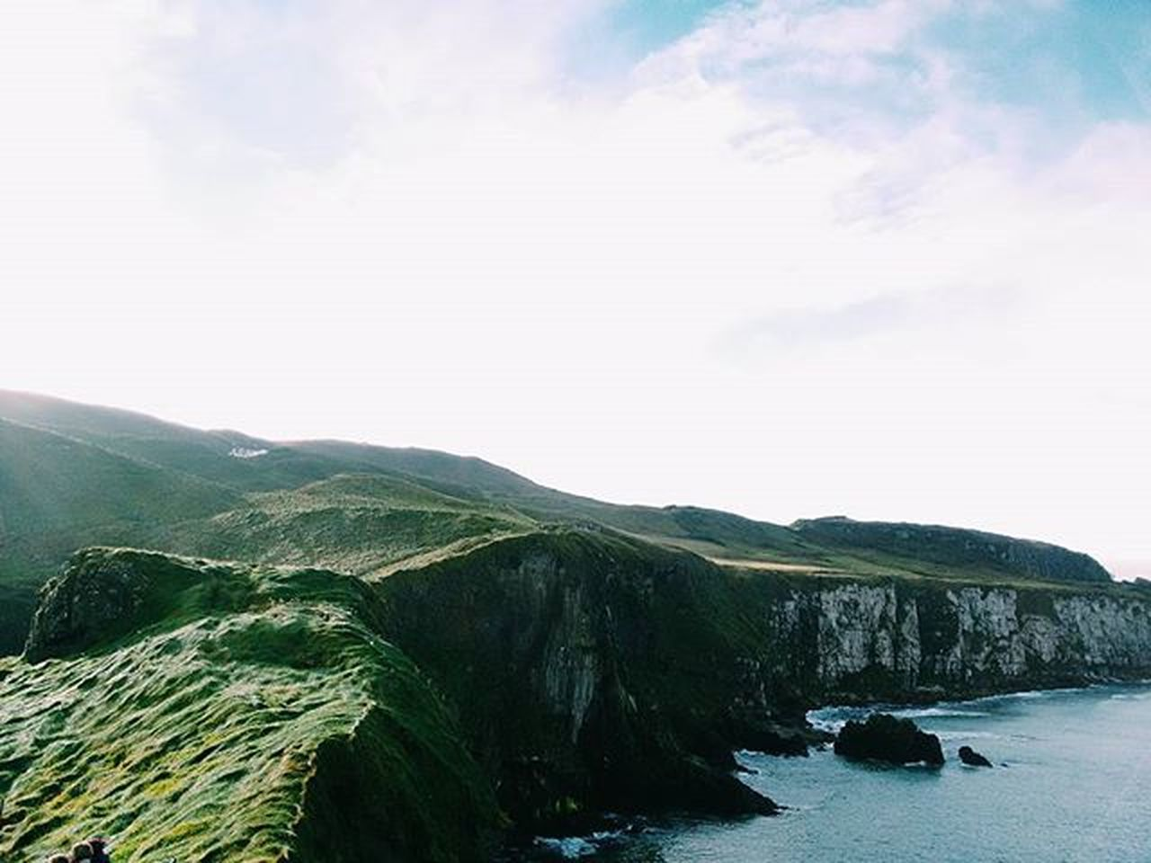 Crossed a scary rope bridge and got this view as a reward Ireland Northernireland Britain Uk Travel Igtravel Travelgram Vscofolk Vscocam VSCO Nature Landscape Cliffs Green