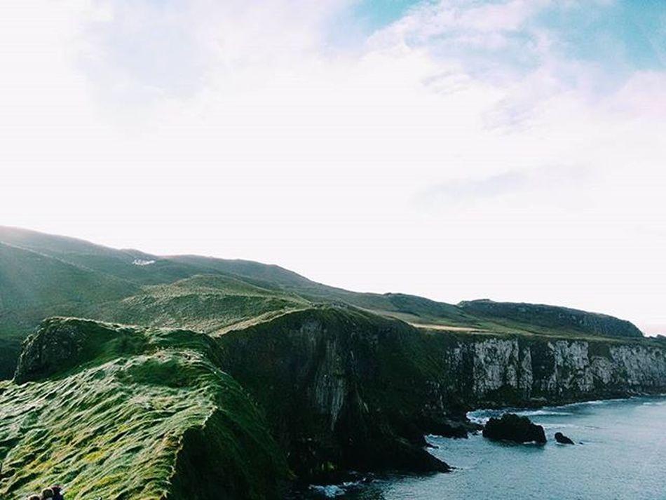 Crossed a scary rope bridge and got this view as a reward Ireland Northernireland Britain Uk Travel Igtravel Travelgram Vscofolk Vscocam VSCO Nature Landscape Cliffs Green