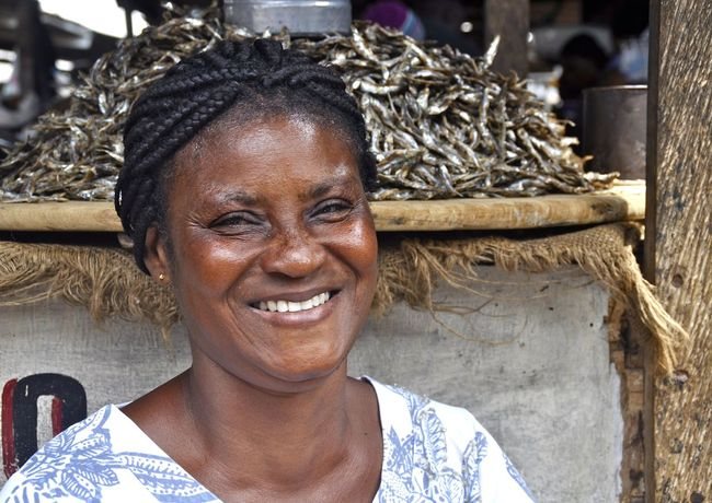Africa African Beauty Close-up Culture Faces Of Africa Faces Of The World Fish Market Friendly Friendly Face Ghana Happy Happy Pepole Headshot Laughing Looking At Camera Market Place Market Woman Mature Adult Person Selling Selling Food Toothy Smile Woman Woman Portrait