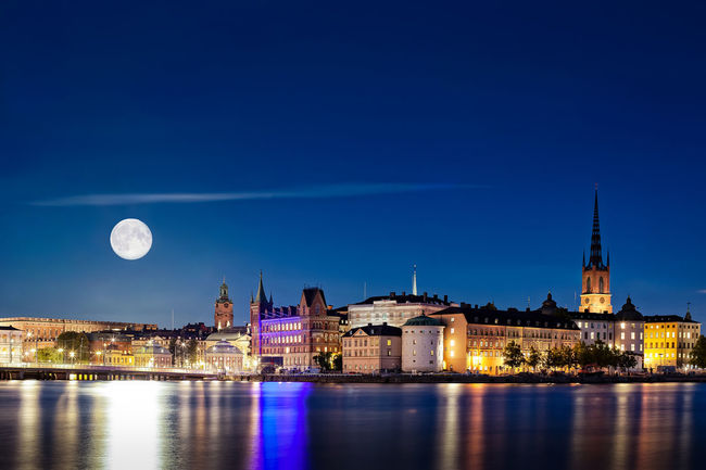 Full Moon (Super moon) rising over Stockholm in 2015. Multiple exposure shot (50mm + 225mm for the Moon). Buildings Capital Cities  City Cityscape Europe Full Moon Fullmoon Moodscape Moon Multiple Exposures Night Nightscape Nordic Countries Reflection Riddarholmen Scandinavia Stockholm Stockholm, Sweden Supermoon Sweden Travel Travel Destinations Travel Photography Water Waterfront
