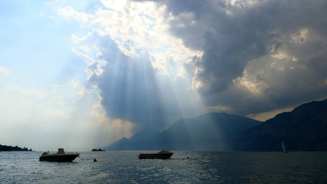 Landscapes With WhiteWall before the storm at Laggo Maggiore Gardasee Garda Lake Italy Storm Clouds Lake Boats Water Sunrays EyeEm Landscape Nature_collection Traveling Tadaa Community Taking Photos