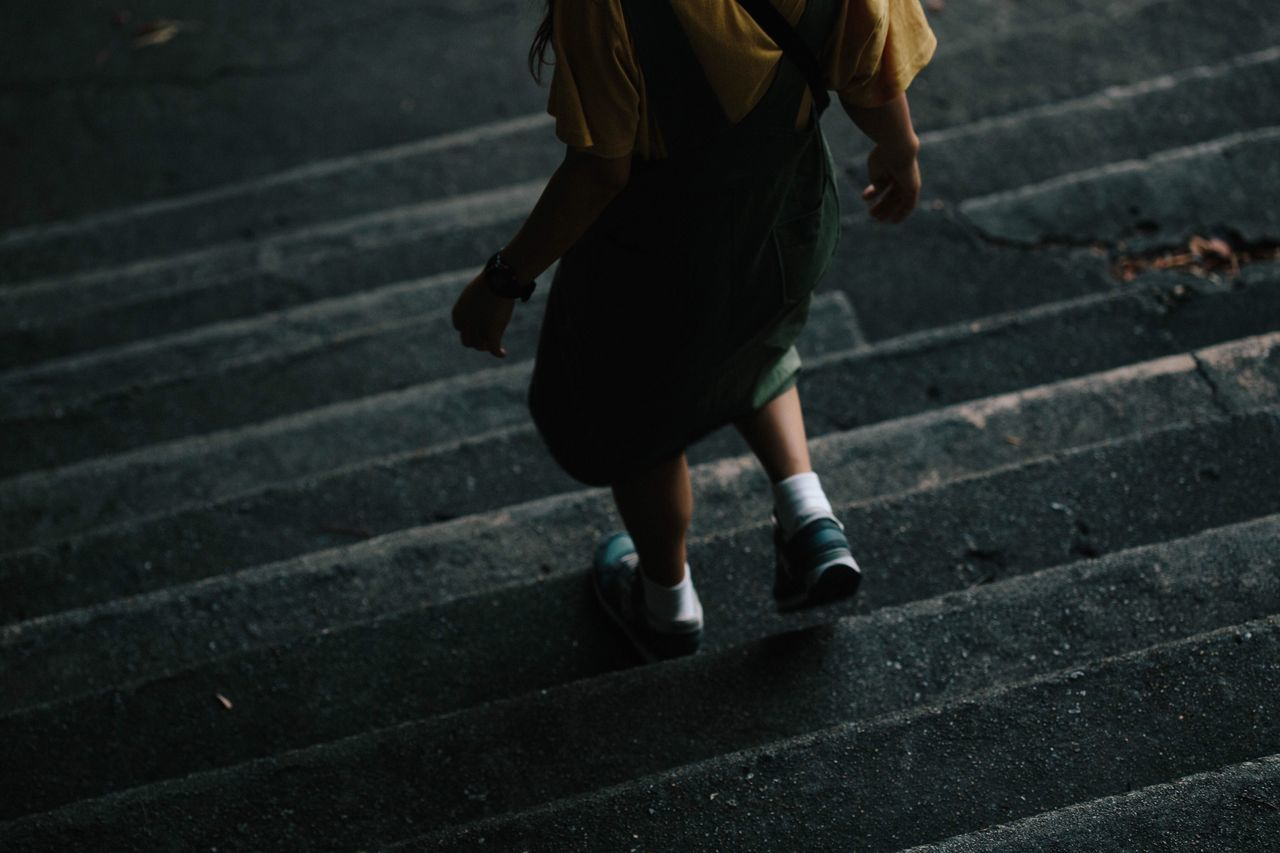 Low Section Of Girl Walking On Steps