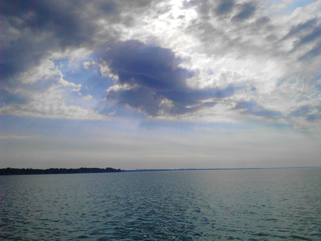 sea, tranquility, beauty in nature, scenics, tranquil scene, water, nature, sky, horizon over water, cloud - sky, idyllic, no people, outdoors, waterfront, day