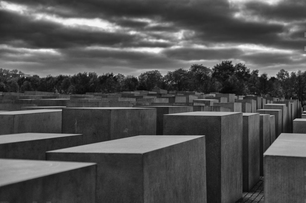 A dramatic view of the Memorial of the murdered jews of Europe B&w Street Photography Berlin Blackandwhite Drama Memorial Of The Murdered Jews Of Europe No People Outdoors Sky Tree War Memorial