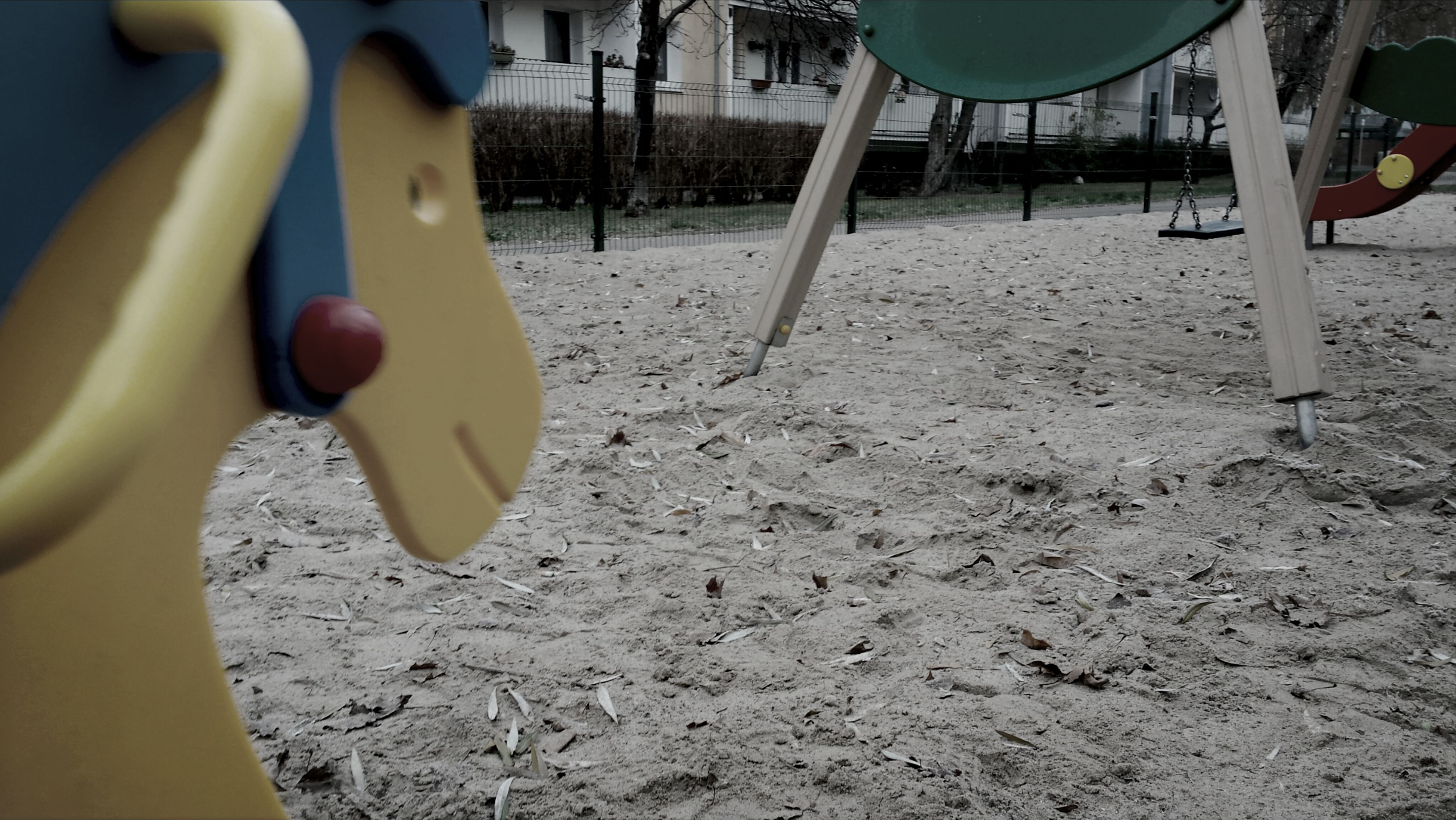high angle view, sunlight, day, playground, childhood, outdoors, close-up, transportation, metal, cropped, part of, wheel, chair, field, no people, absence, shadow, street, front or back yard, equipment