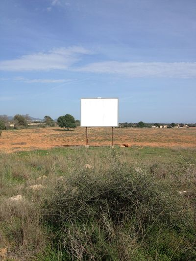 Advertising Billboard Day Field Grass Landscape Nature No People Outdoors Plakat Portrait Sky