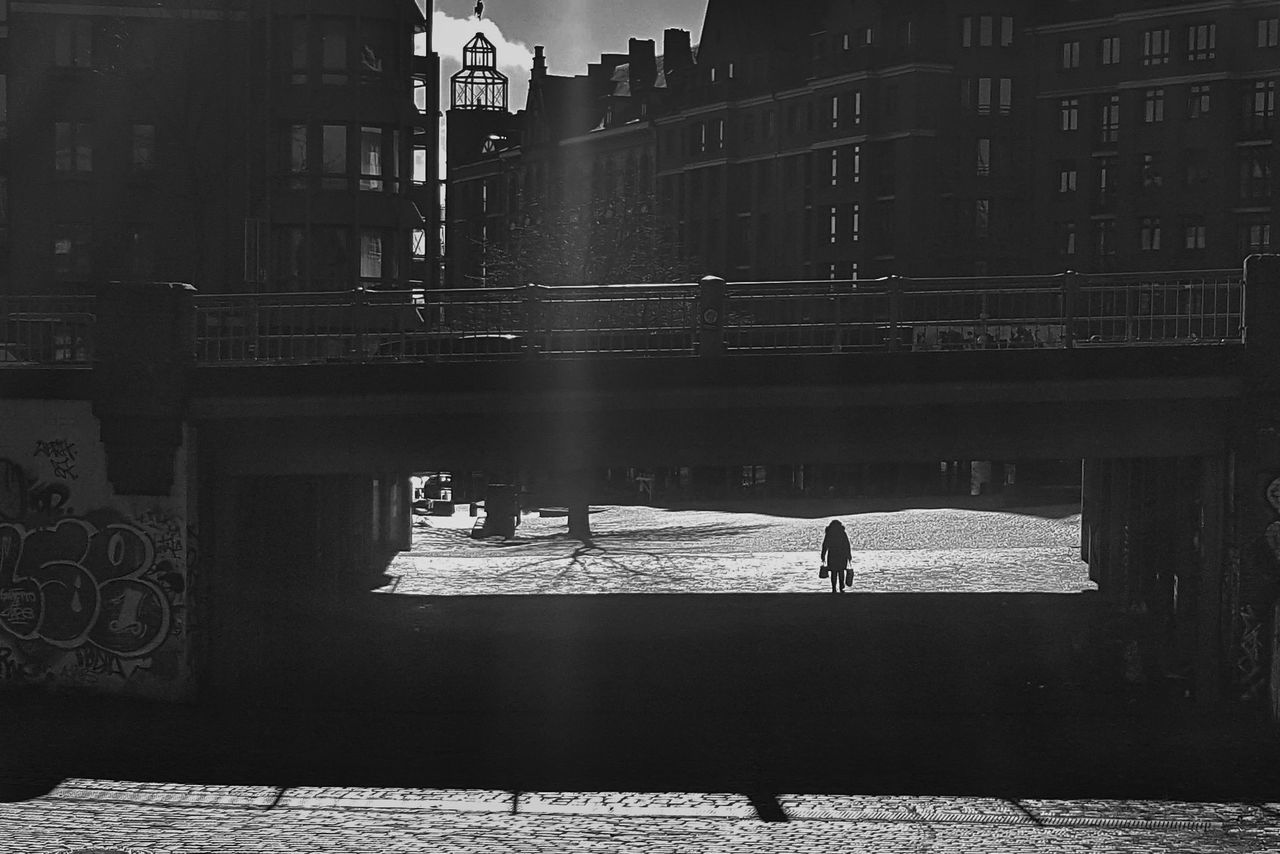 Black And White Photography Bridge Overpasses Shopping Woman At Work Walking Street Hamburg Germany Smartphone Photography Streetphotography Architecture One Person Clouds And Sky Hard Life Hard Light The Secret Spaces Break The Mold