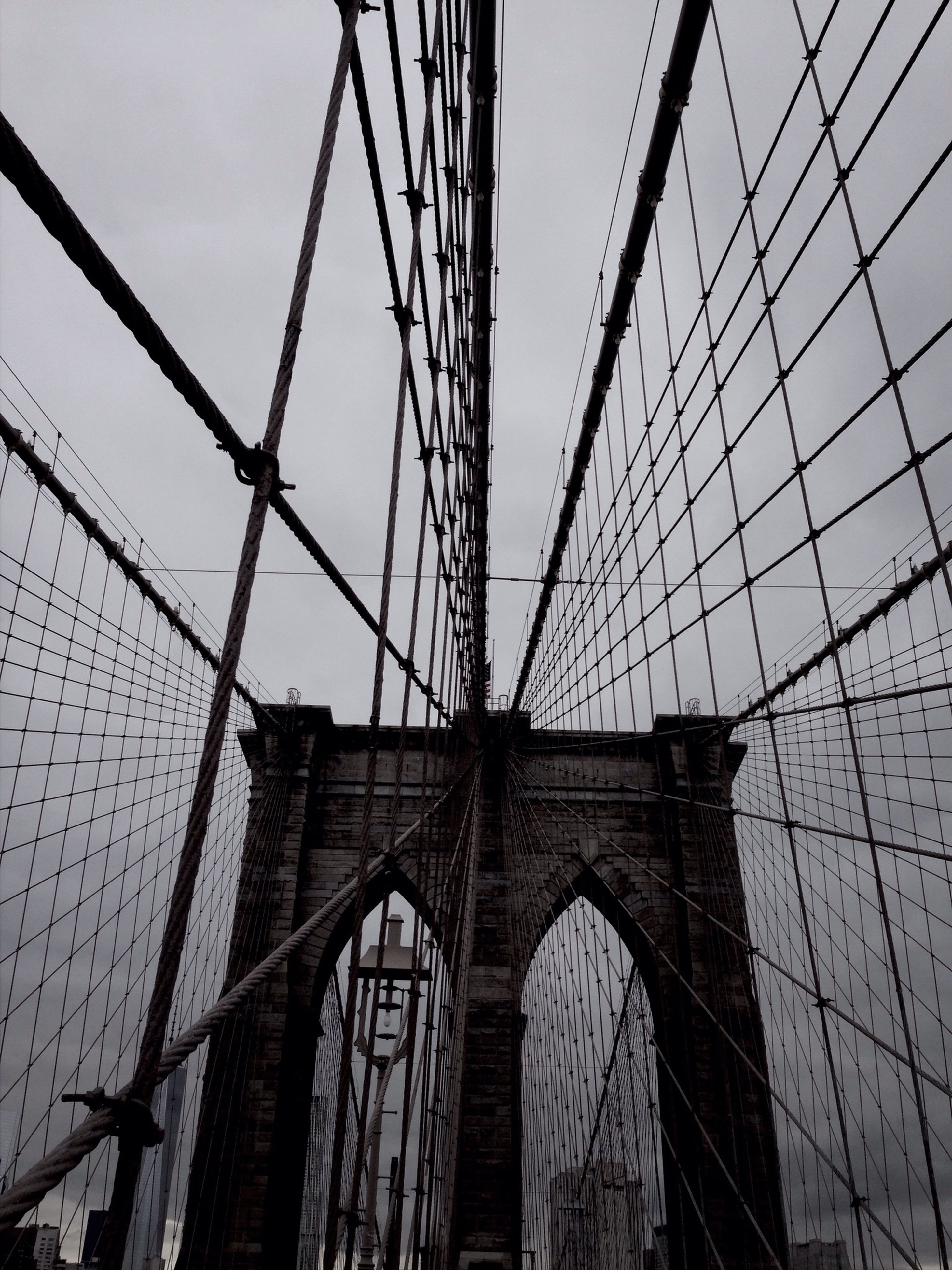architecture, built structure, low angle view, connection, building exterior, sky, engineering, bridge - man made structure, city, suspension bridge, cable, clear sky, outdoors, day, no people, metal, travel destinations, modern, famous place, tower