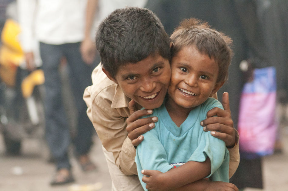 MASTER OF EMOTION - TWO BROTHERS LOOKING OUT OF EACH OTHER IN THE SLUMS OF NEW DELHI Brothersforlife Kids Photography Poor Children Poor Kids Poverty But Happiness Poverty Lives.