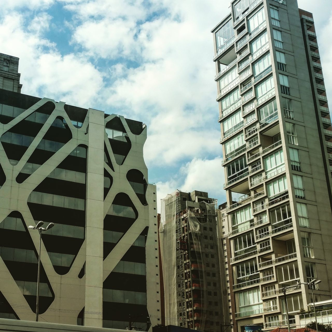 architecture, building exterior, built structure, low angle view, sky, modern, day, outdoors, skyscraper, city, no people