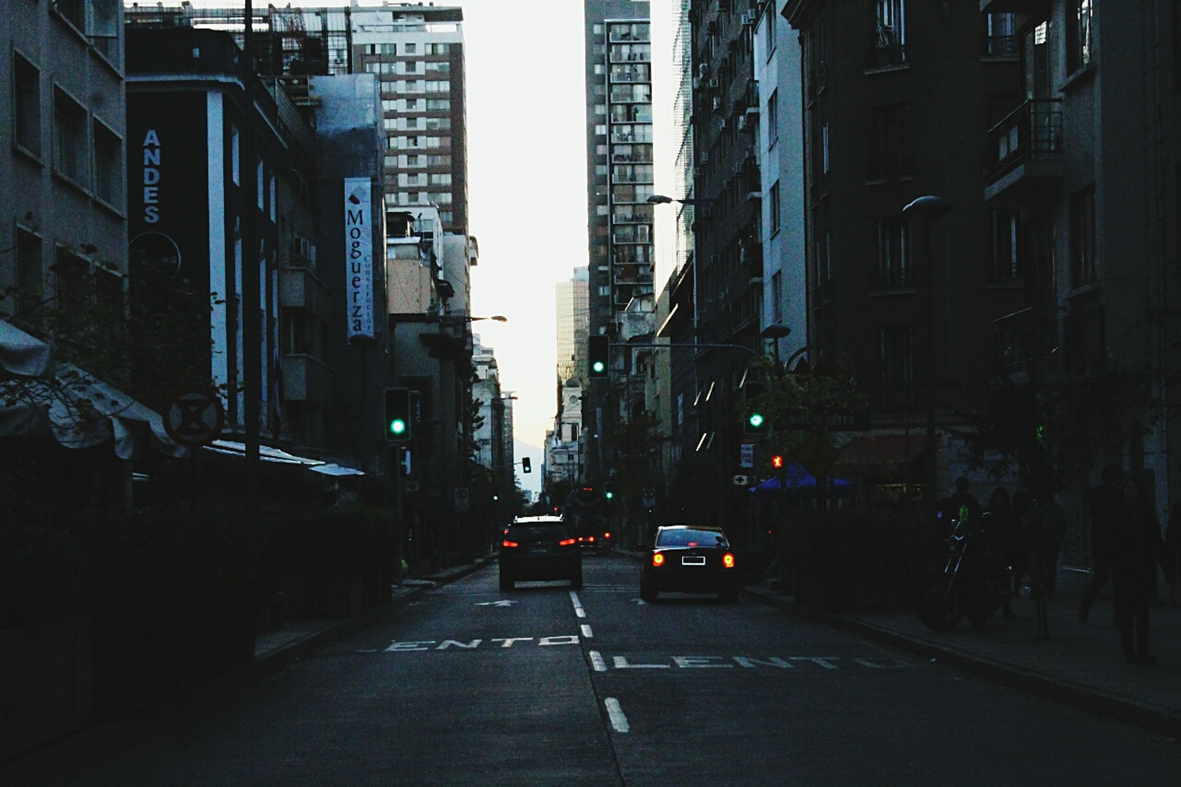 city, car, transportation, street, architecture, building exterior, city street, built structure, the way forward, traffic, road, land vehicle, city life, no people, outdoors, yellow taxi, illuminated, skyscraper, day, sky