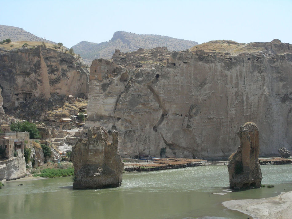 A last look at Hasankeyf before its flooded by the reservuar waters :( Almost Gone  Beauty In Nature Day Geology Hasankeyf Hasankeyfkoprusu Heritage Site Lake Landscape Mountain Nature No People Outdoors Scenics Sky Tranquility Travel Destinations Travel Photography Turkey Water