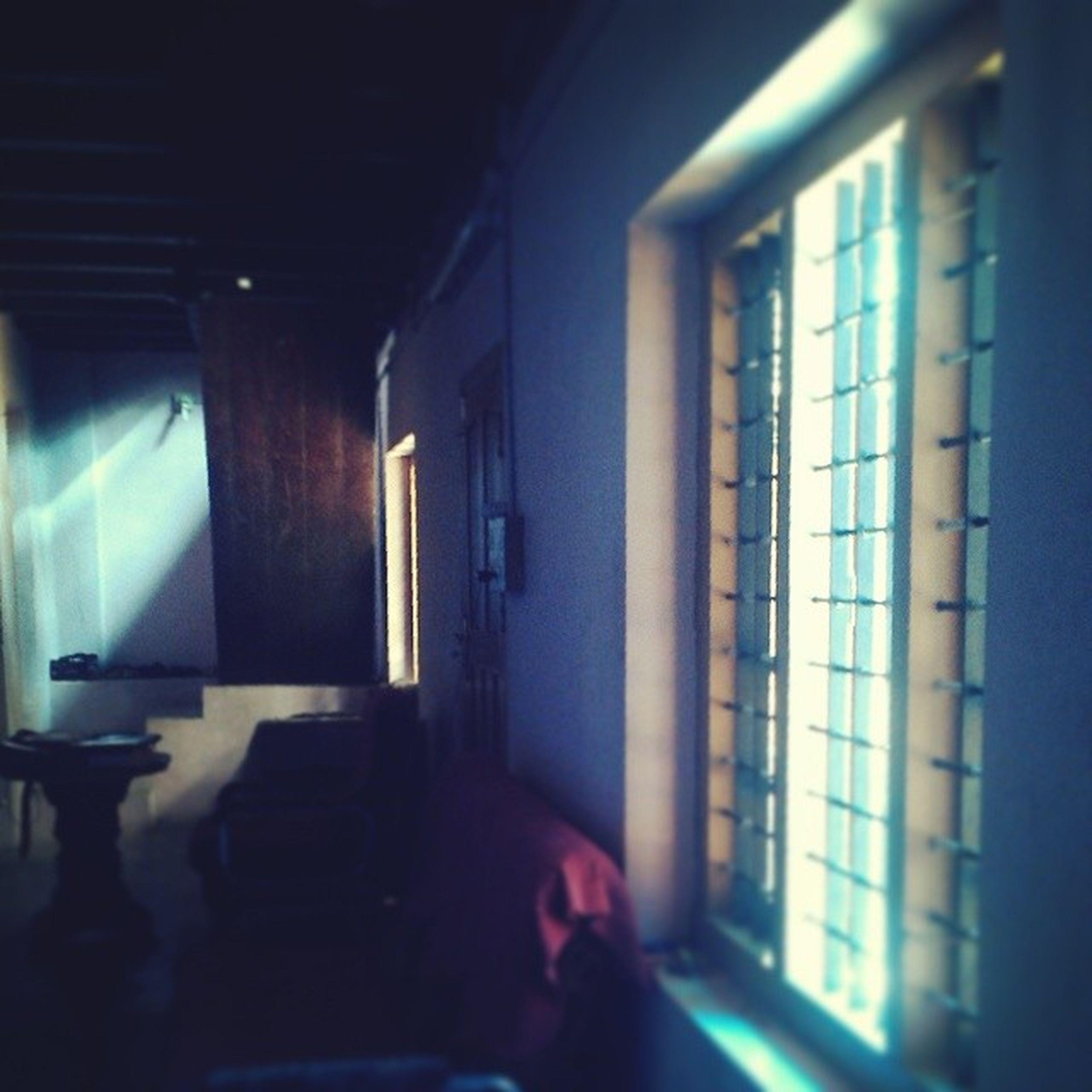 indoors, window, empty, absence, illuminated, interior, architecture, home interior, built structure, chair, room, domestic room, corridor, door, no people, sunlight, lighting equipment, house, dark, flooring