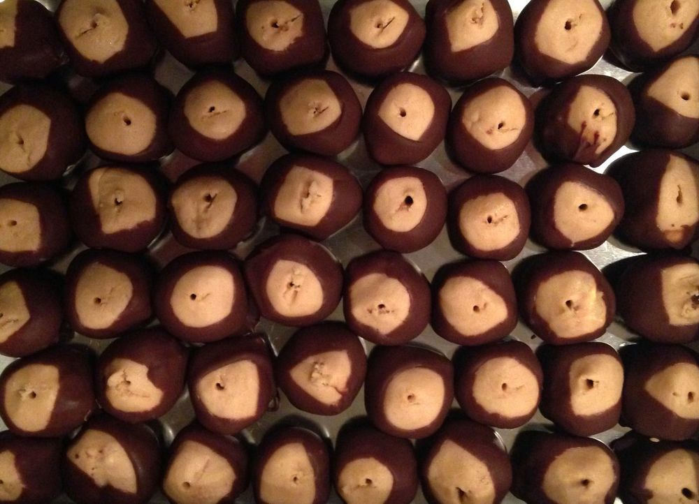 Buckeyes. Traditional holiday sweet treat. Peanut butter flavored balls dipped in chocolate. Full Frame Treat Candy Confection Buckeyes Holiday Tradtional Large Group Of Objects Backgrounds Arrangement Food No People Indoors  Pan Tree Buckeye Tree
