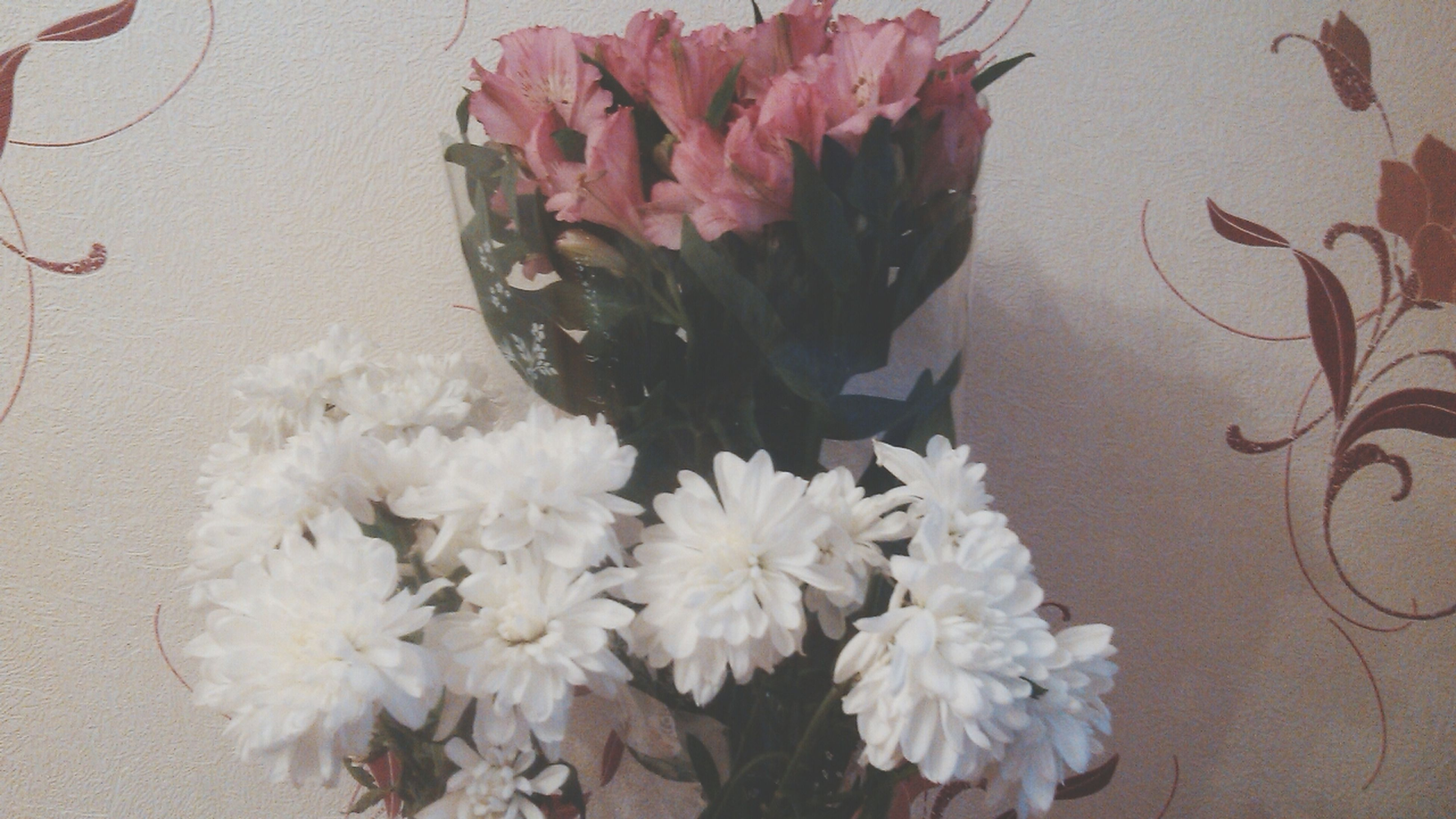 flower, freshness, indoors, petal, fragility, high angle view, flower head, vase, table, close-up, decoration, still life, pink color, rose - flower, white color, bouquet, beauty in nature, plant, nature, no people