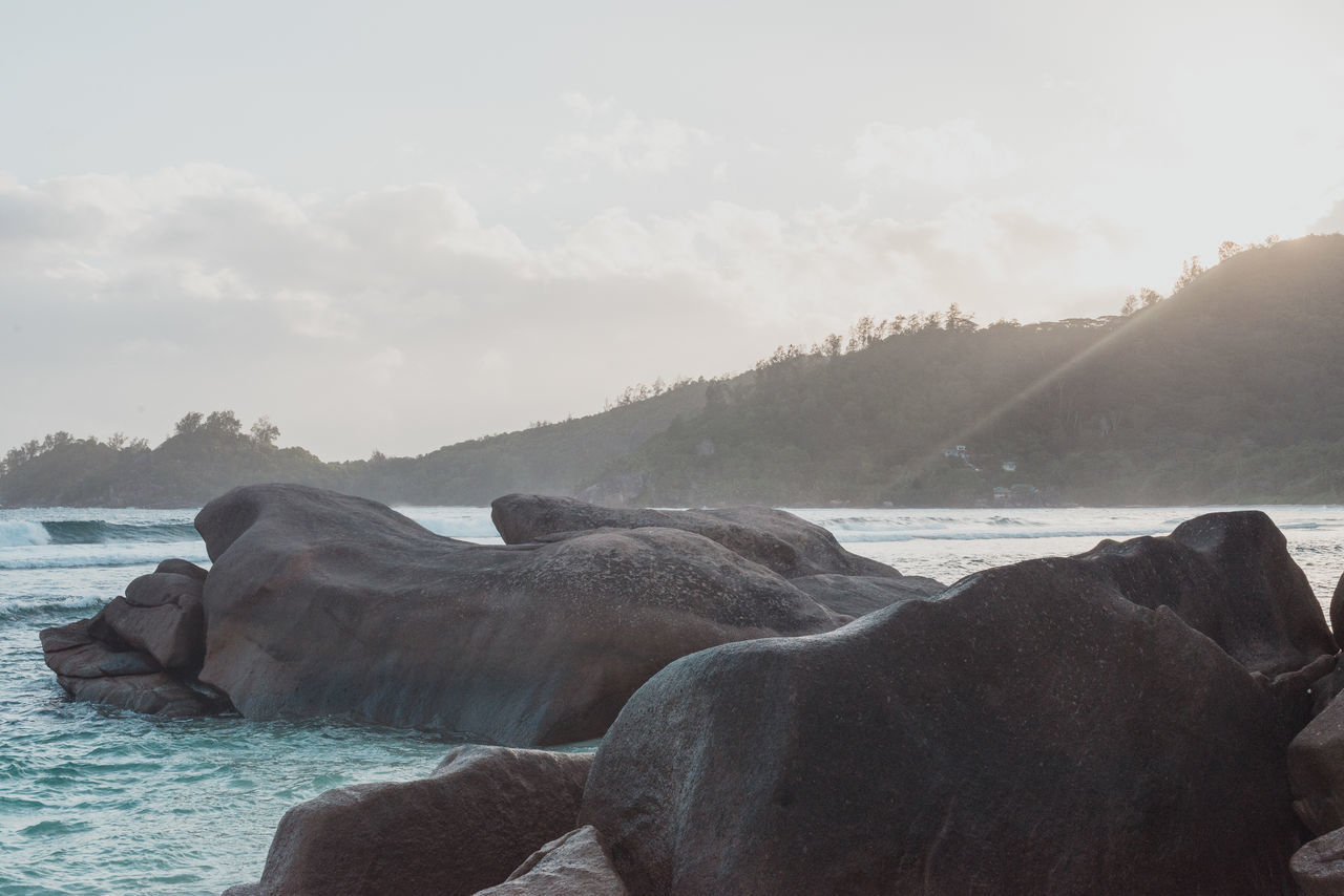 Time to contemplate Beauty Beauty In Nature Day Horizontal Mahé Nature No People Ocean Outdoors Rocks In The Ocean Rocks In The Sea Rocks In Water Sea Seychelles Sunset Water