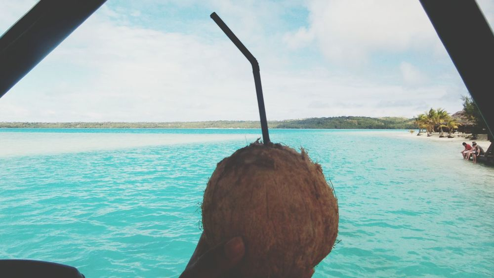 A Drink to the Islands: paikura © AITUTAKI EyeEm Best Shots AMPt_community Eye4photography  The View From My Window Holiday POV Cook Islands Coconut Catamaran Blue Water Original Experiences