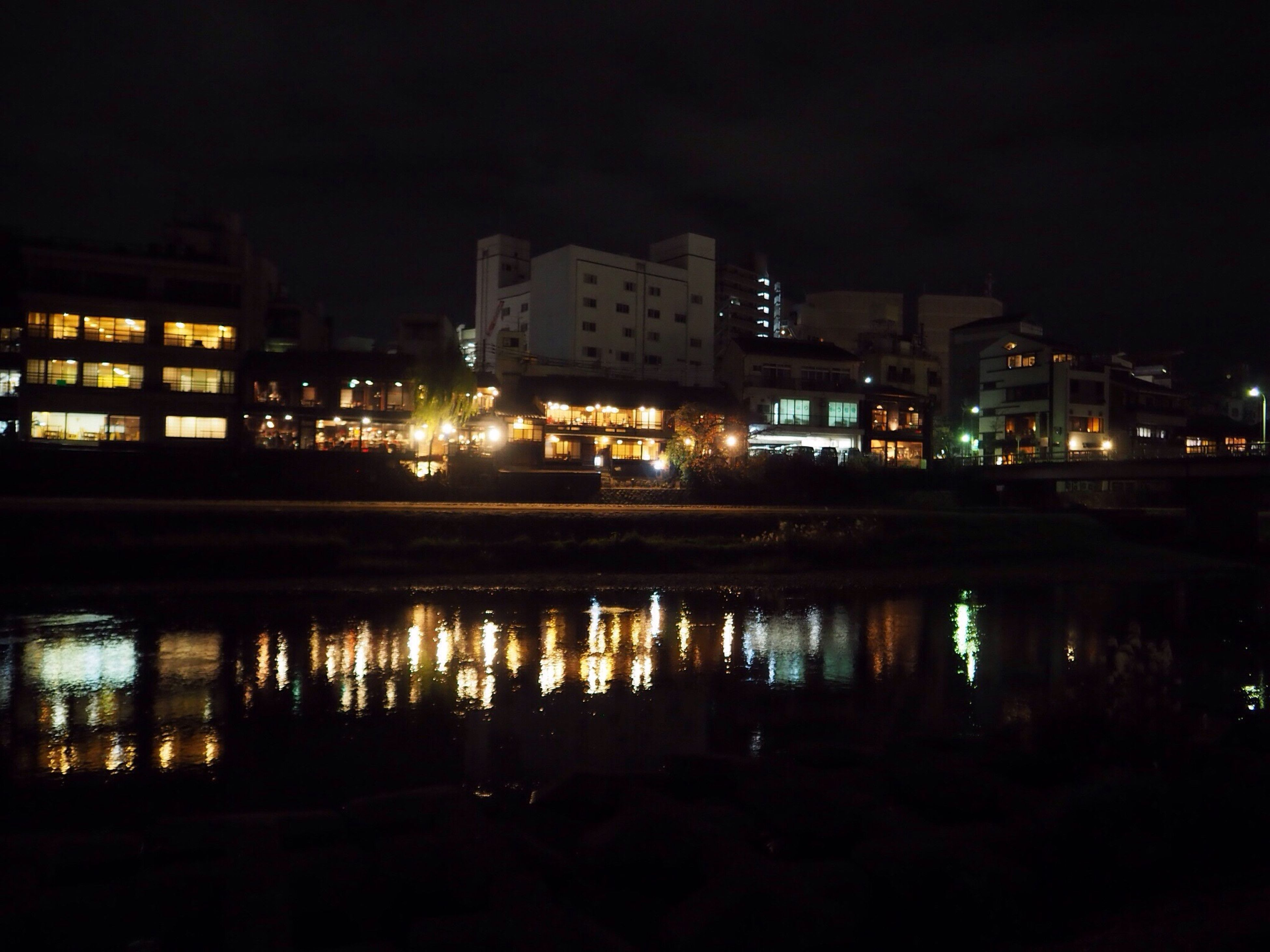 reflection, architecture, night, illuminated, building exterior, built structure, city, water, sky, no people, outdoors, cityscape