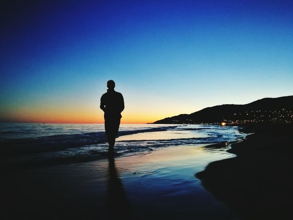 People And Places Endofholidays Sunset Sea Water Standing Horizon Over Water Beach Men Lifestyles Clear Sky Mountain Beauty In Nature Scenics Tranquil Scene