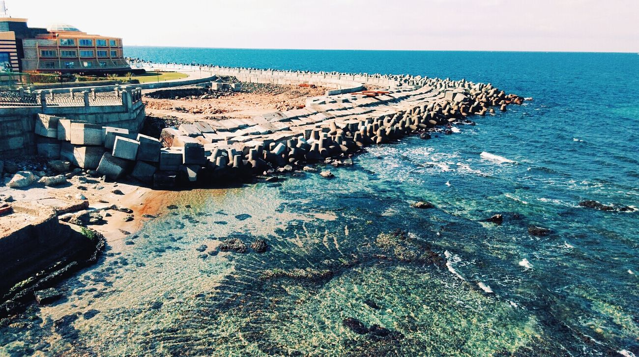 Sea Water Sky Day Nature Beauty In Nature Shore Alexandria Egypt Carnival Crowds And Details Alexandria This Is Egypt Nature Contrast Colors Wanderlust Skylover Clear Sky Shades Of Nature Shades Of Blue Wave Blue Vs Green Rocks Nature Photography Blues Heaven Love Of Nature