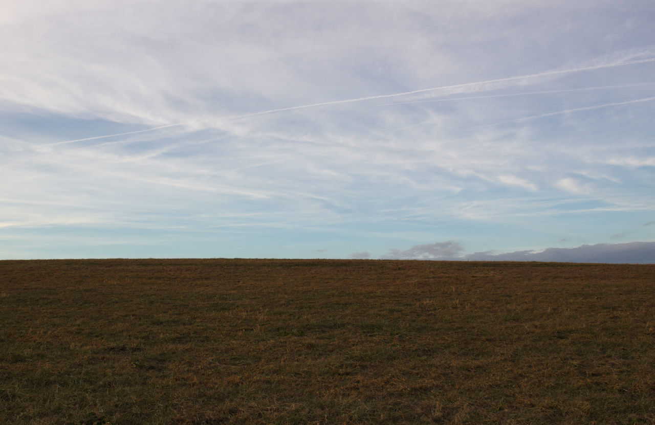 field, landscape, nature, sky, agriculture, tranquility, scenics, beauty in nature, no people, tranquil scene, day, rural scene, outdoors, vapor trail