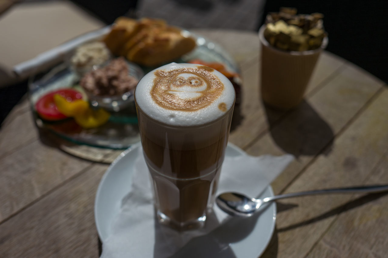 Latte Macchiato with a smile Cafe Cappuccino Close-up Coffee - Drink Coffee Cup Day Drink Drinking Glass Food Food And Drink Freshness Froth Art Frothy Drink Indoors  Indulgence Latte Latte Macchiato Mocha No People Ready-to-eat Refreshment Saucer Table Temptation