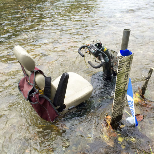 Stolen mobility scooter dumped in river Broken Crime Crime Scene Criminal Damage Destroyed Destruction Disabled Dumped Dumped In River High Angle View Looking Down Machine Mobility Mobility Aid Mobility Scooter No People Police Tape Pollution River Ruined Stolen Vandalised Vandalized Water Wrecked