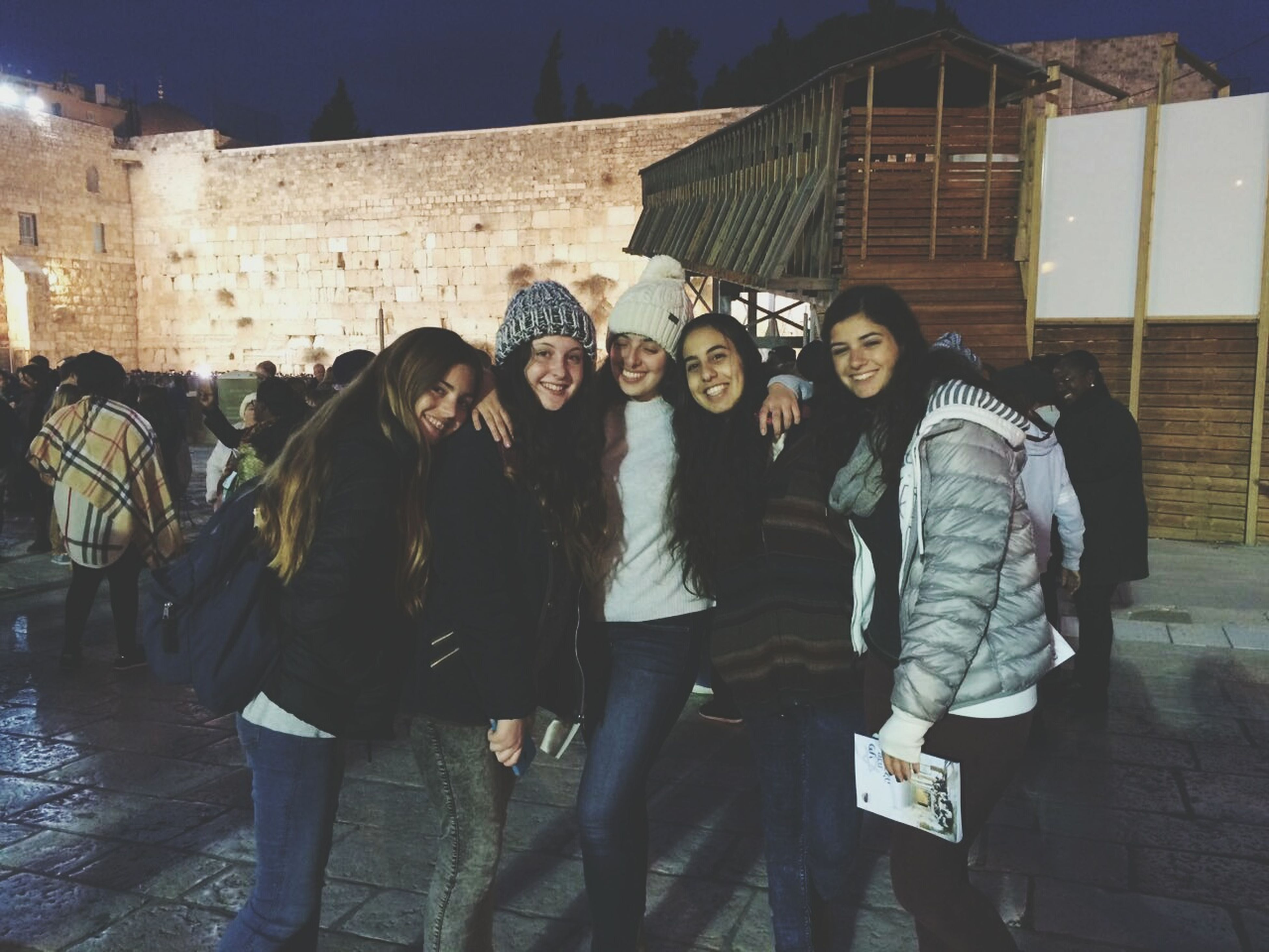 building exterior, architecture, leisure activity, friendship, young women, casual clothing, built structure, young adult, lifestyles, city, togetherness, women, outdoors, happiness, smiling, real people, cheerful, day, people, adult, adults only