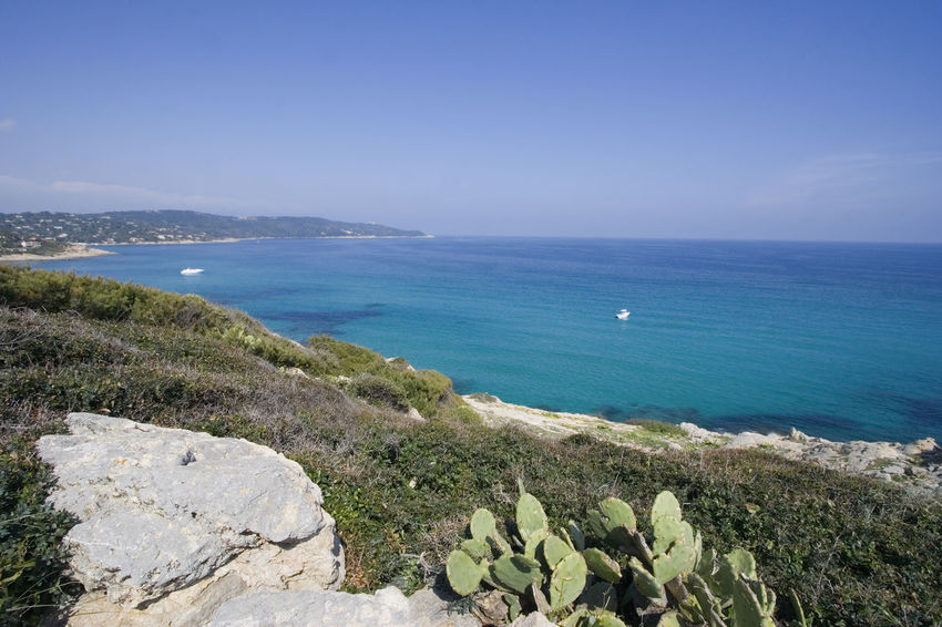 panorama of the mediterranean sea - ocean, cliffs and yachts Beach Beauty In Nature Clear Sky Cliff Coastline Côte D'Azur France Gulf Of Saint-tropez High Angle View Horizon Over Water Landscape Mediterranean Sea Nature Nautical Vessel No People Ramatuelle Rock - Object Rocky Coastline Saint-Tropez Scenics Sea Seascape Tranquility Travel Destinations Water