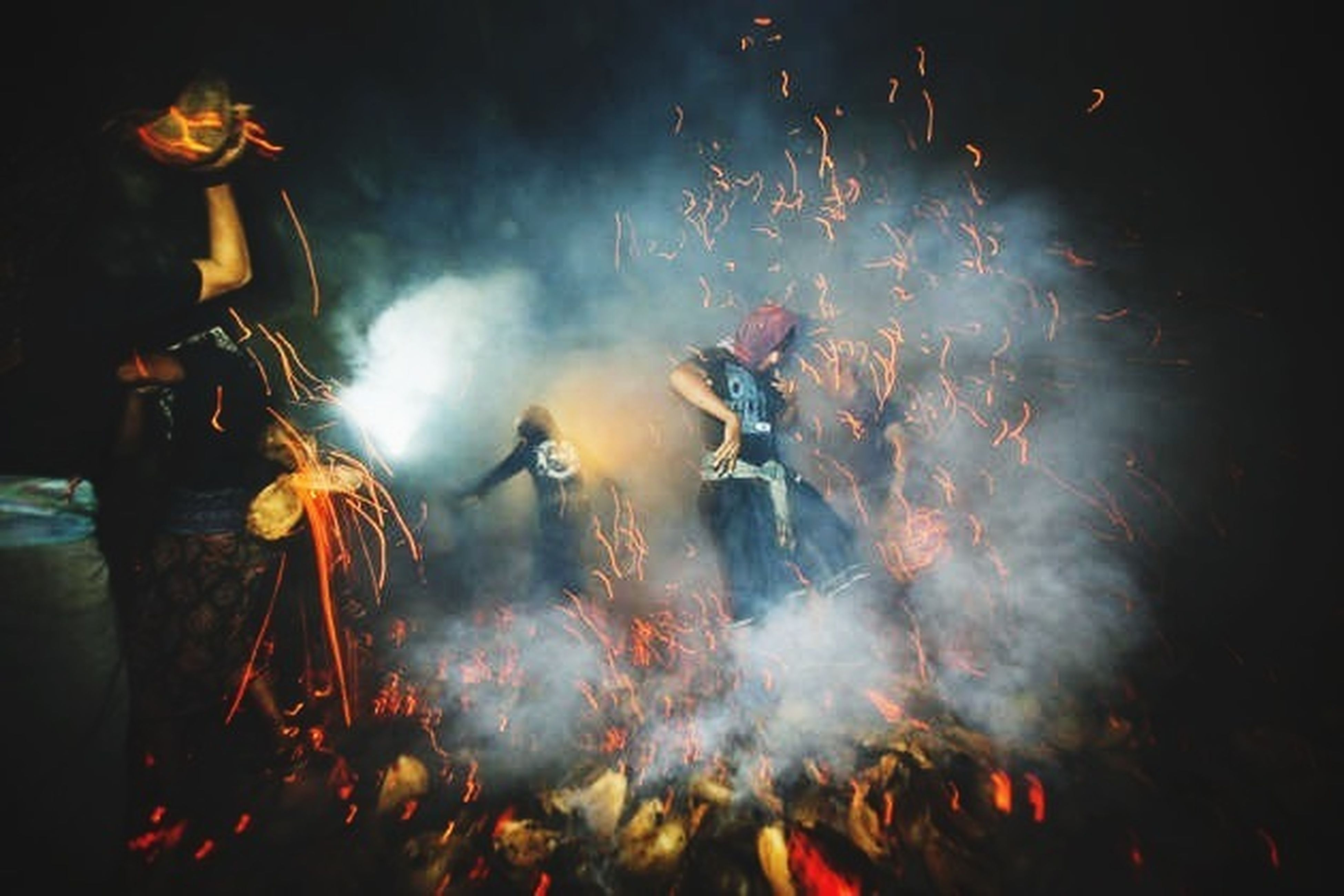 night, arts culture and entertainment, illuminated, enjoyment, event, lifestyles, leisure activity, celebration, fun, large group of people, men, motion, excitement, firework display, togetherness, sparks, crowd, glowing, performance