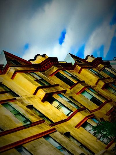 Low Angle View Architecture Building Exterior Cloud - Sky Yellow Tall - High Building Story Veiwpoint Of A Homeless Seattle Girl ShotoniPhone6s Puget Sound, Washington