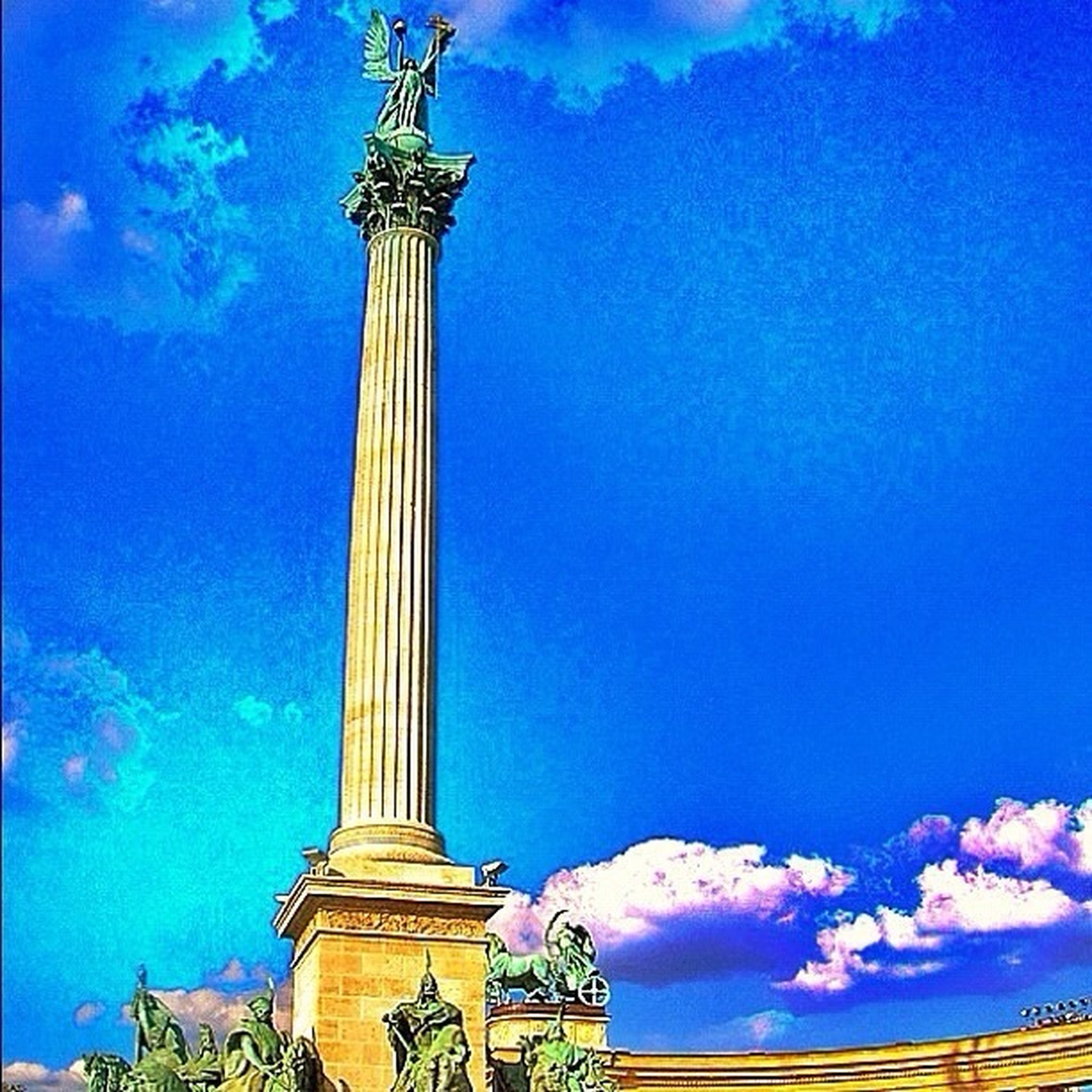 low angle view, blue, sky, built structure, architecture, cloud - sky, building exterior, cloud, famous place, history, travel destinations, religion, outdoors, tall - high, tower, travel, no people, place of worship, tourism, international landmark