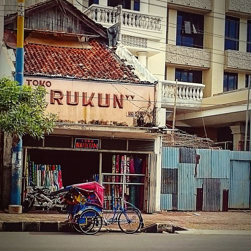 Old shop in the corner... Building Exterior Architecture City Transportation Outdoors Day Old Building Exterior Vintage Old Architecture Downtown District Clear Sky Exterior City INDONESIA Indonesia_allshots Amateurphotographer  XperiaZUltra Mobilephotography Amateurphotography Amateurphotographer  Streetphotographer Streetphotography Architecture Becak Old Town