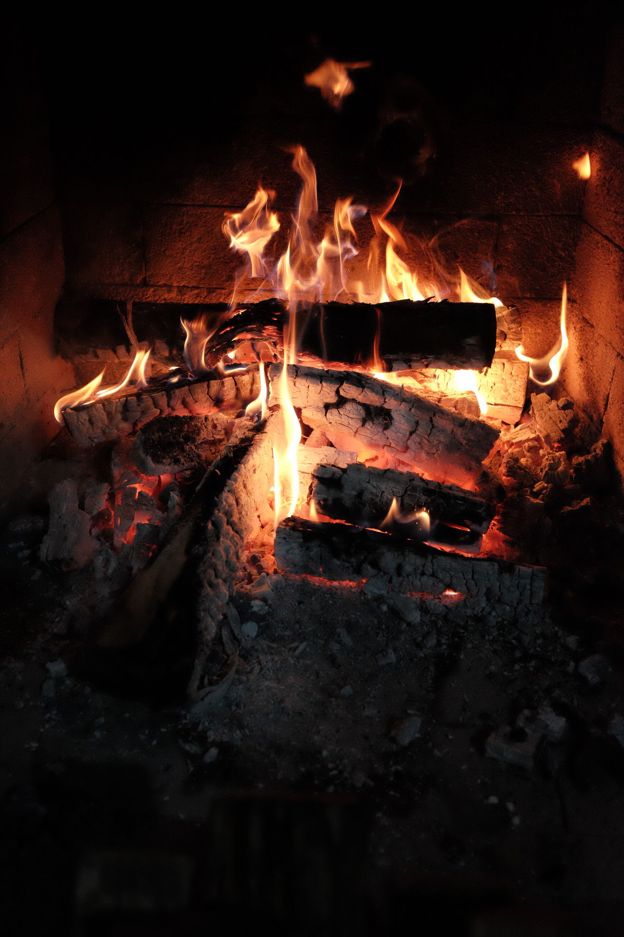 Warming Up With A Bonfire Bonfire Burning Close-up Fire - Natural Phenomenon Fire Wood Burning Flame Glowing Heat - Temperature Indoors  Night No People