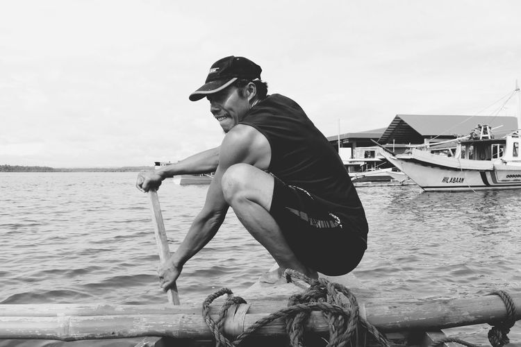 EyeEm Selects One Man Only Only Men One Person Adult Side View Cloud - Sky Sea Water People Adults Only Day Sky Outdoors Summer Cap Full Length Nautical Vessel Men Multi Colored Real People Philippines Philippines Photos Fisherman Fishermen Black And White Friday