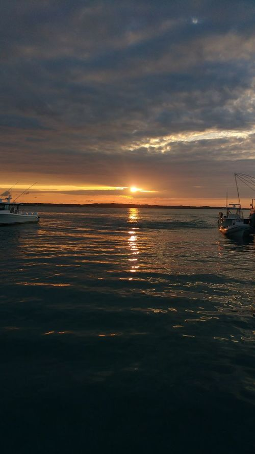 Sunset Sea Travel Tranquility Outdoors Reflection Beauty In Nature Travel Destinations Scenics Tourism Nature Dramatic Sky Cloud - Sky Water Luxury Vacations Transportation Travel Business Finance And Industry Bahamas Ocean Caribbean Marina Dock Boats Yachts