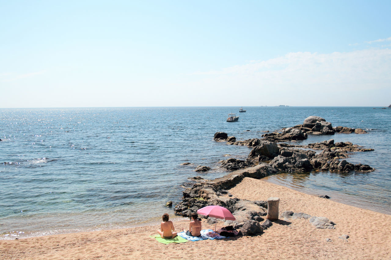 Calella de Palafrugell Adult Beach Clear Sky Day Full Length Horizon Horizon Over Water Leisure Activity Live For The Story Nature Outdoors People Rear View Sand Sea Sitting Sky Standing Togetherness Two People Vacations Water Women