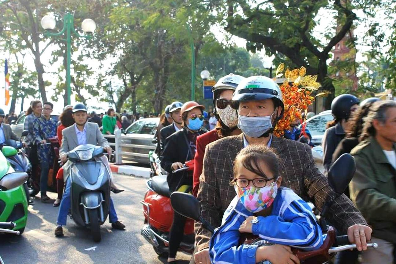 a frozen moment in chaos Hanoi, Vietnam Transportation Motorbike Crazy Tet Holiday