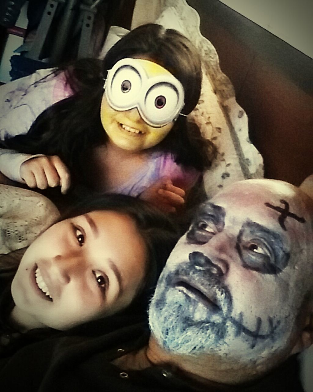looking at camera, real people, indoors, portrait, home interior, leisure activity, two people, spooky, togetherness, lifestyles, childhood, men, bonding, young women, close-up, halloween, young adult, mammal, day