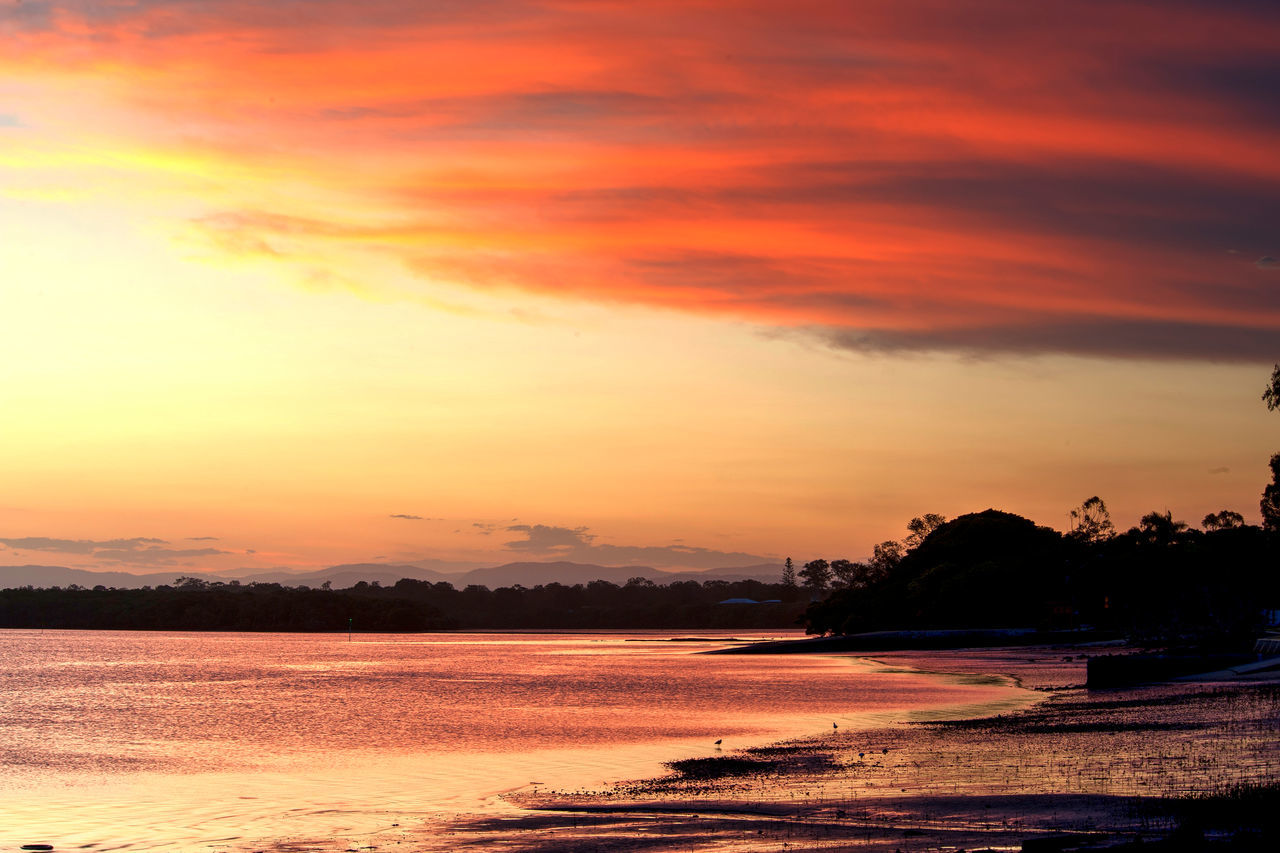 sunset, sky, water, silhouette, orange color, scenics, tranquil scene, cloud - sky, sea, beauty in nature, tranquility, nature, outdoors, no people, beach, tree, day