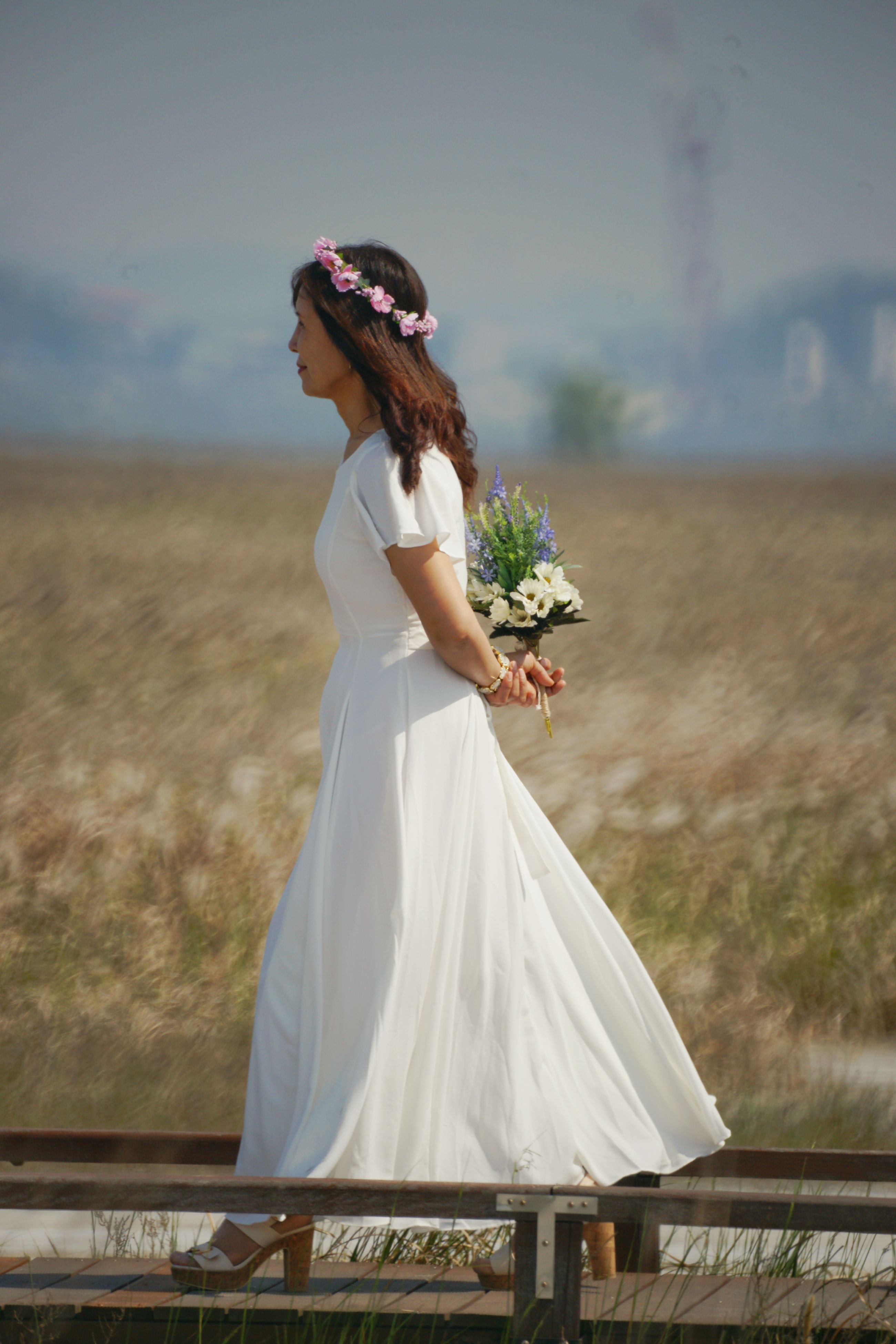 bride, wedding, women, young adult, real people, wedding dress, one person, young women, lifestyles, standing, life events, outdoors, love, sky, day, nature, leisure activity, celebration, flower, beautiful woman, beauty in nature, groom, people