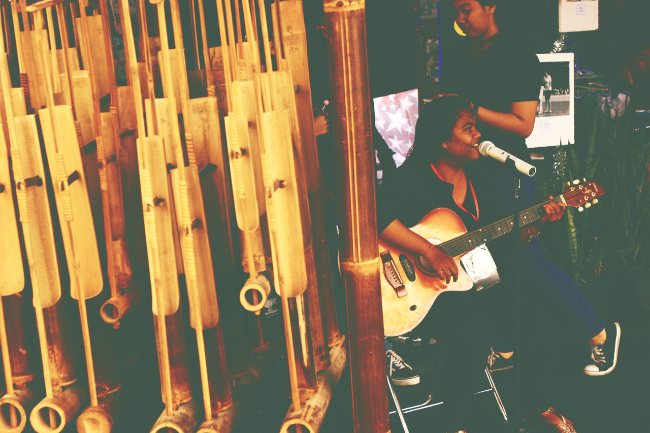 Bamboo Angklung and acoustic guitar Music Music Culture Indonesia Culture Angklung Acoustic Guitar Perfomance Stage Festival Arts Culture And Entertainment Musical Instrument Electric Guitar Lifestyles Musical Equipment Playing Musician Guitar Technology Performance Young Adult Sound Recording Equipment