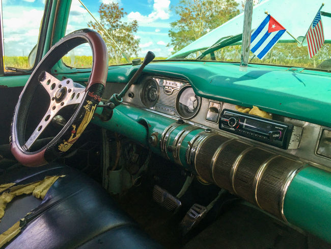 Art Of Traveling Car Car Interior Check This Out Cuba Damaged Eyeemphoto Eyeemphotography Flags Mode Of Transport No People Obsolete Old American Car Old Style Old-fashioned Oldtimer Part Of Sixties Special Steering Wheel Transportation Travel Turquoise Colored Used Look My Favorite Place