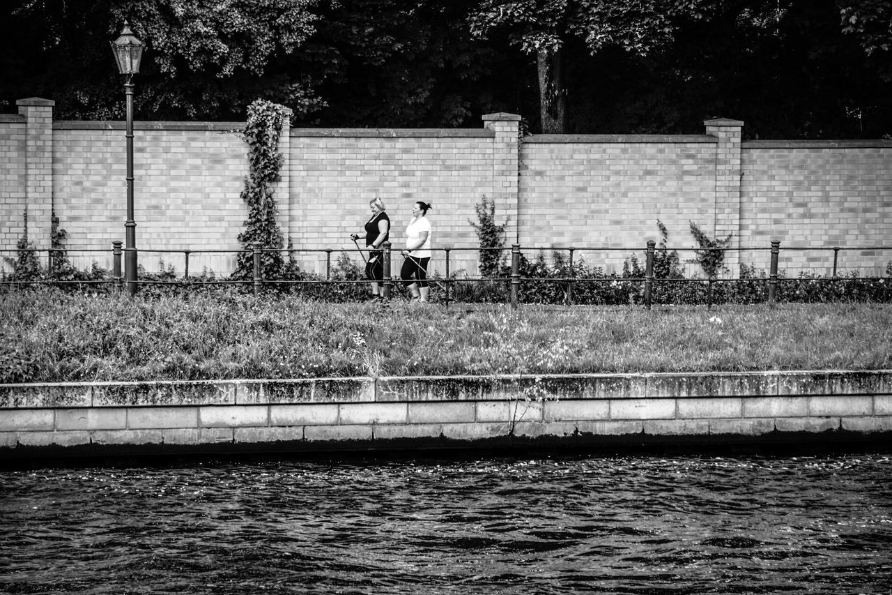walk & talk Berlin Discussion Fence Footpath Jogging Ladies Long Outdoors Park Railing River Sport Sports Street Photography Streetphoto_bw Talking Talking Photo The Way Forward Walking Walking Around Walkway