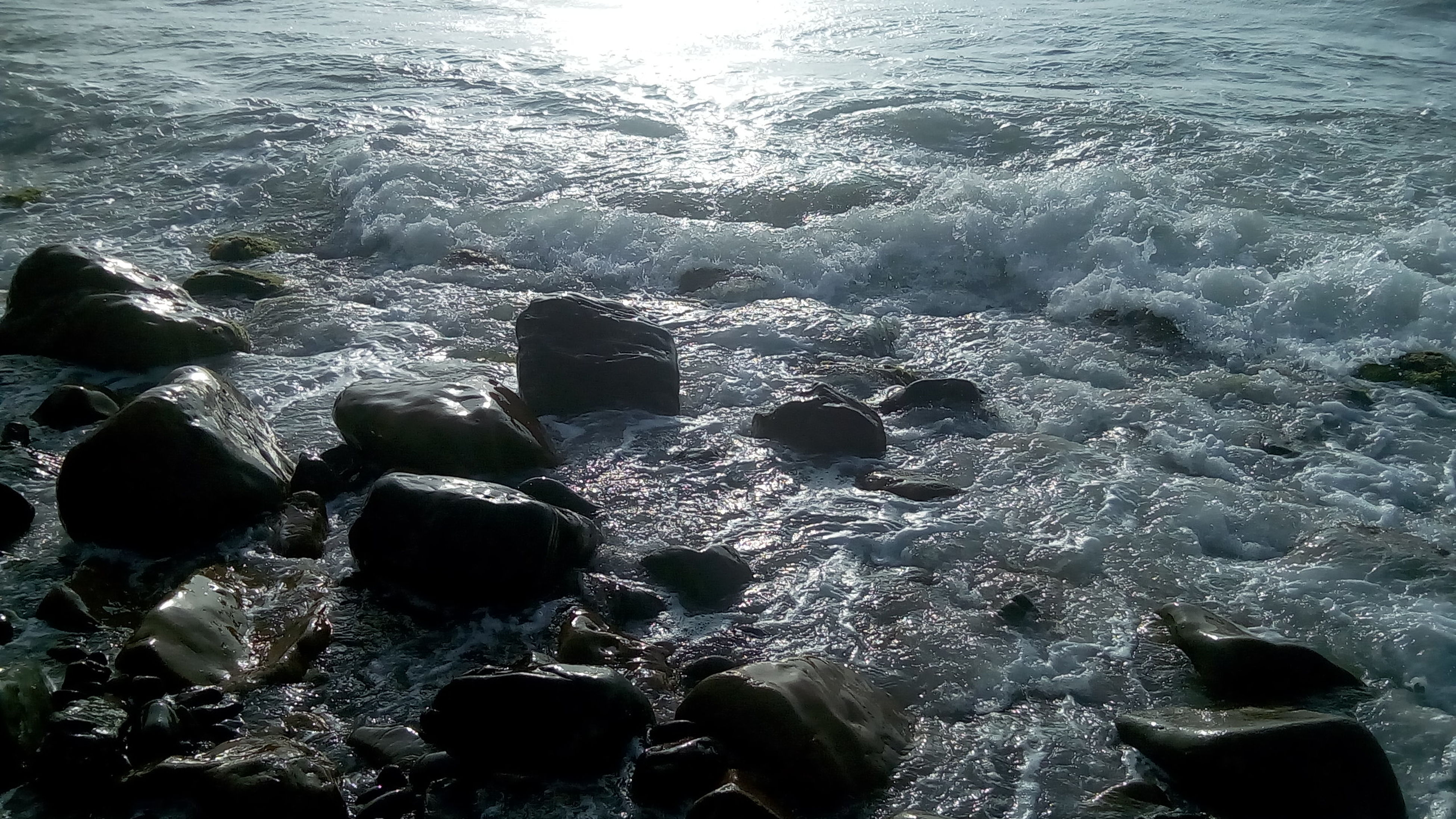 water, sea, shore, wave, rock - object, nature, tranquility, beauty in nature, rippled, stone - object, outdoors, scenics, day, no people, backgrounds, full frame, tranquil scene, idyllic, remote, non-urban scene, close-up, elevated view