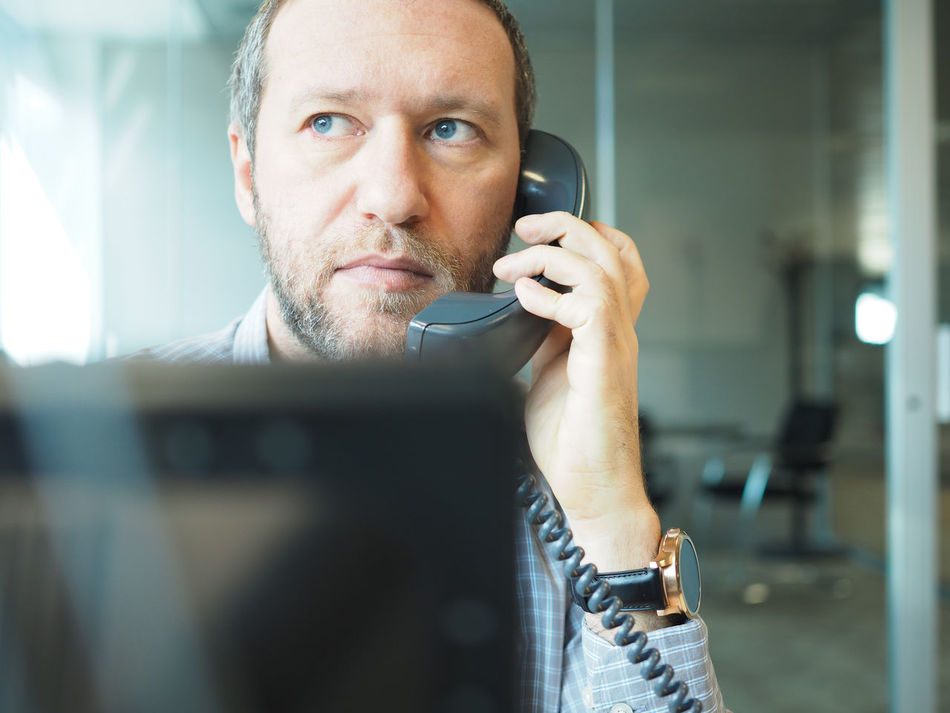 Answering Business Business Finance And Industry Business Person Businessman Call Communication Man Man Head Monitor Negotiate Office Office View Officeman One Person Phone Shirt Shirt Man Telephone Telephone Cable Telephone Line Using Phone Work Work Man Employed